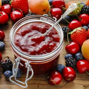 depositphotos_88619002-stock-photo-jar-of-strawberry-jams-among